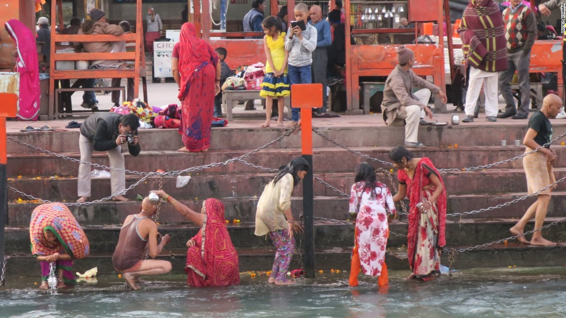 <strong>Feet-dipping: </strong>Dipping your feet in the Ganges is tradition -- as displayed by this group in Haridwar. But the river runs rapidly and the banks can be slippery with moss, so do exercise caution.