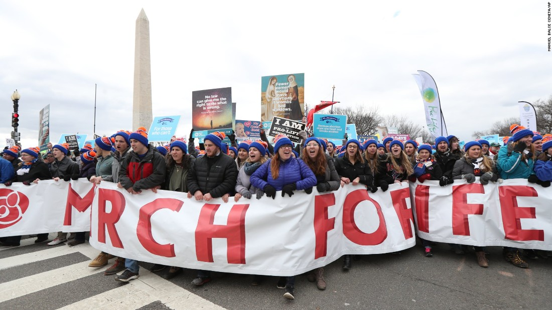 Participants march near the National Mall.
