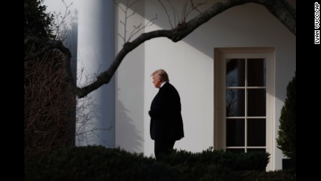 President Donald Trump walks from the Oval Office to board Marine One on the South Lawn of the White House in Washington, Thursday, Jan. 26, 2017, for a short trip to Andrews Air Force Base, Md. then on to Philadelphia for the Republican Congressional retreat. (AP Photo/Evan Vucci)