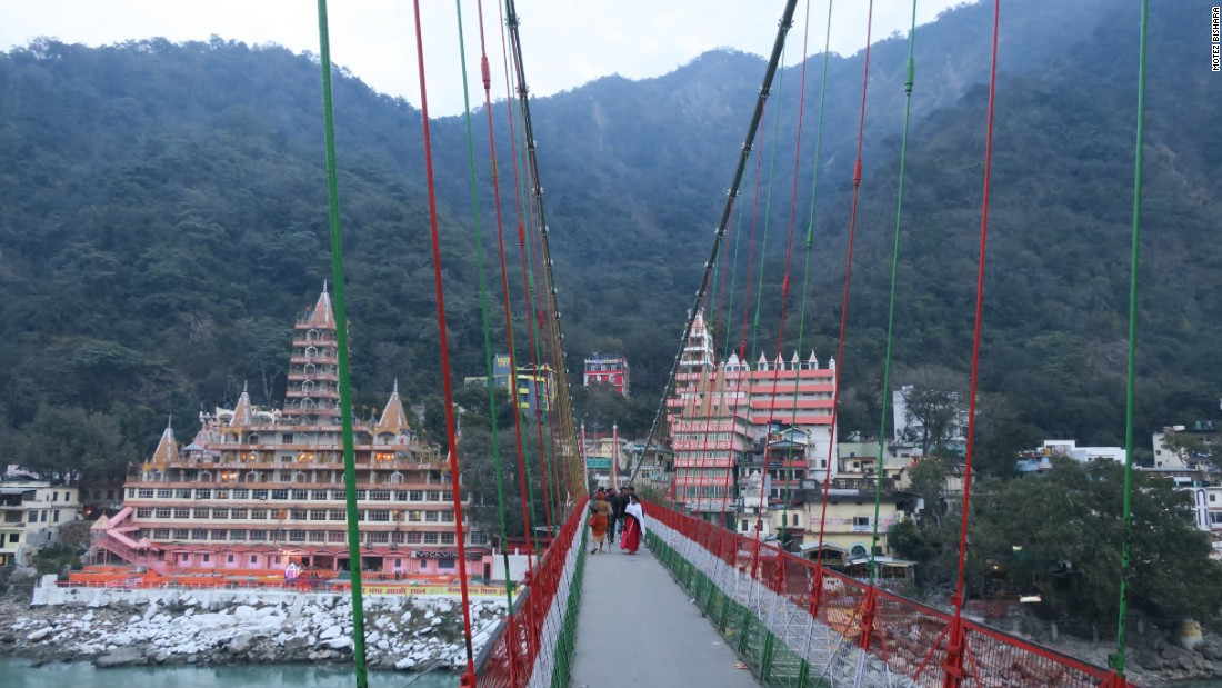 <strong>Kailashananda: </strong>A view of the enormous Kailashananda ashram from the other side of the Ganges, with the busy Lakshman Jhula foot bridge connecting the two sides of town.