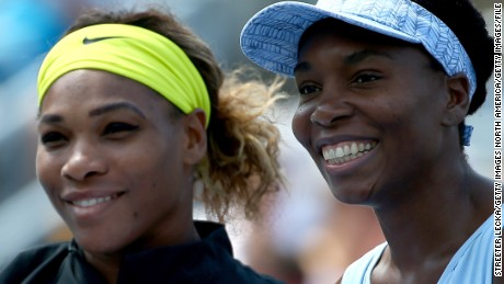 MONTREAL, QC - AUGUST 09:  (L-R) Serena Williams of the USA and Venus Williams of the USA pose before their women's semifinals match in the Rogers Cup at Uniprix Stadium on August 9, 2014 in Montreal, Canada.  (Photo by Streeter Lecka/Getty Images)