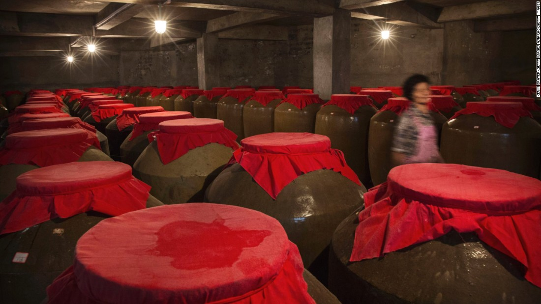 <strong>Four types of baijiu: </strong>Vats of fermenting baijiu are covered with red cloth. Baijius are categorized by four aroma profiles: rice, light, strong and sauce.