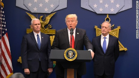 US President Donald Trump speaks the ceremonial swearing-in of James Mattis (R) as secretary of defense on January 27, 2016 at the Pentagon in Washington, DC. The oath was administered by US Vice President Mike Pence (L) / AFP / MANDEL NGAN        (Photo credit should read MANDEL NGAN/AFP/Getty Images)
