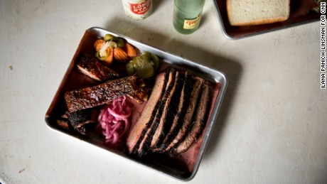 House made pickles, onions and jalapenos accompany pork ribs and brisket at Truth BBQ in Brenham.