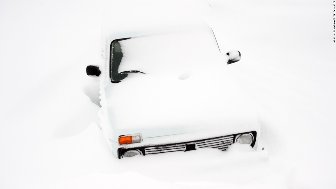 A car is covered in snow near Breitenau, Germany, on Monday, January 16.