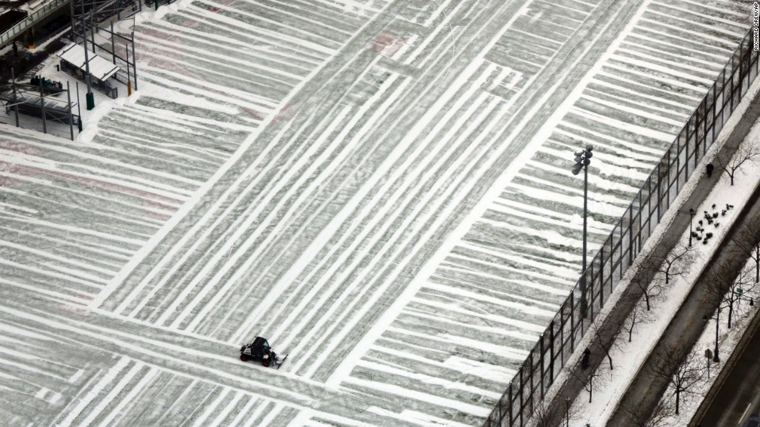 A plow clears a playground in New York City on Monday, January 9.