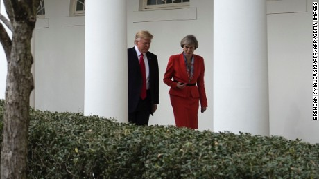 US President Donald Trump and British Prime Minister Theresa May walk to a press conference at the White House on January 27, 2017 in Washington, DC. / AFP / Brendan Smialowski        (Photo credit should read BRENDAN SMIALOWSKI/AFP/Getty Images)