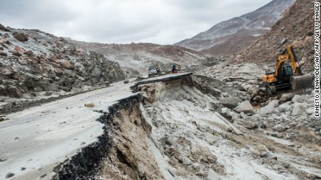 View of the Peruvian Panamerican highway after a landslide in Arequipa, southern Peru, on January 27, 2017. Floods and landslides in Peru have killed four people and displaced more than 11,000 families over recent weeks, the authorities said Friday. Three people drowned when their vehicle was caught in a flood in the southern Arequipa region, the National Civil Defense Institute said. / AFP / Ernesto BENAVIDES        (Photo credit should read ERNESTO BENAVIDES/AFP/Getty Images)