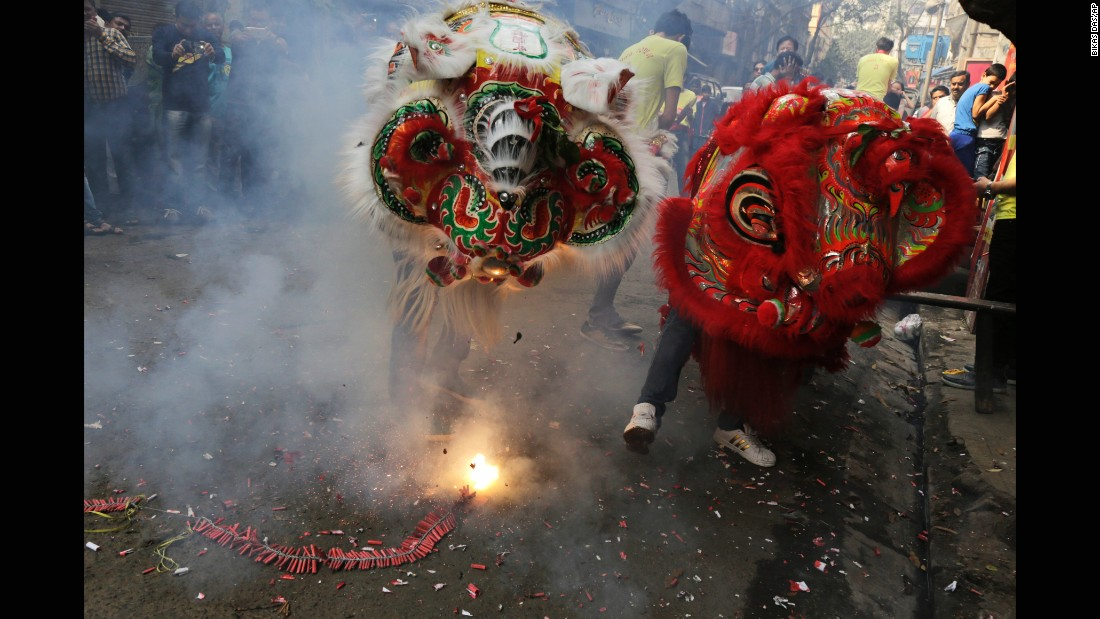 Loud noises are said to drive away evil spirits, but not these lion dancers at a Chinese settlement in Kolkata, India.