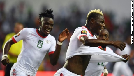 Aristide Bance celebrates with his Burkina Faso teammates after scoring the opening goal against Tunisia.