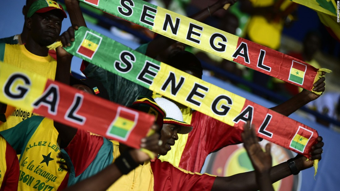 Senegal supporters cheer on their team -- many pundits tipped the 2002 runners up to win the tournament this year.