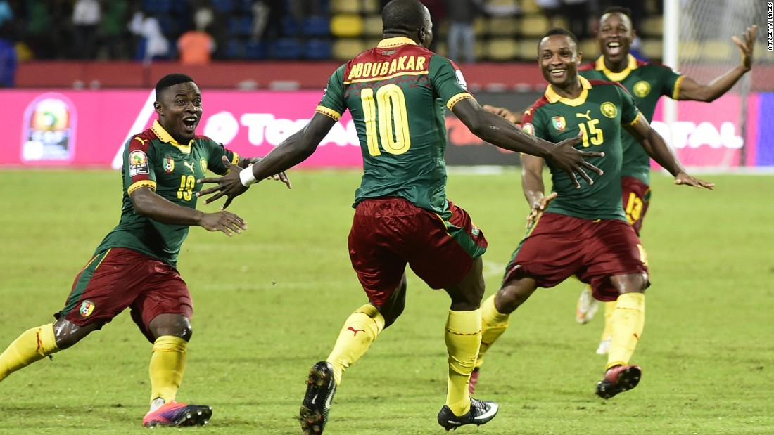 Cameroon's players celebrate after winning the penalty shootout against Senegal in Franceville.