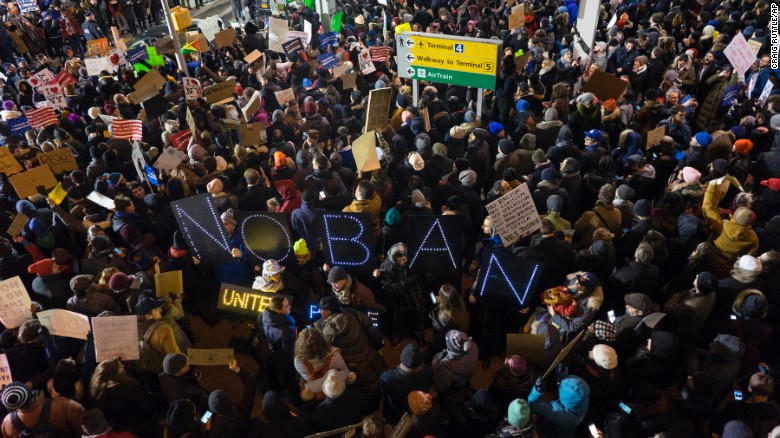Protesters assemble at John F. Kennedy International Airport in New York, Saturday, Jan. 28, 2017, after earlier in the day two Iraqi refugees were detained while trying to enter the country. On Friday, Jan. 27, President Donald Trump signed an executive order suspending all immigration from countries with terrorism concerns for 90 days. Countries included in the ban are Iraq, Syria, Iran, Sudan, Libya, Somalia and Yemen, which are all Muslim-majority nations. [AP Photo/Craig Ruttle)