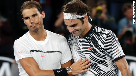 Switzerland's Roger Federer, right, is congratulated by Spain's Rafael Nadal, after Federer won the men's singles final at the Australian Open tennis championships in Melbourne, Australia, Sunday, January 29, 2017.