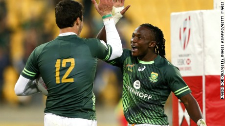 Ruhan Nel (left) celebrates with Player of the Final Seabelo Senatla after their side's victory over Fiji in the final.