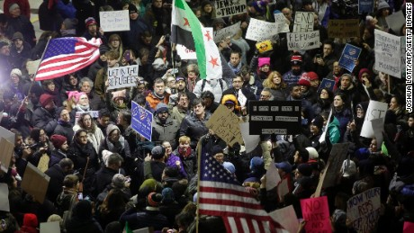 Demonstrators protest agaist President Trump's executive immigration ban at Chicago O'Hare International Airport on January 28, 2017. US President Donald Trump signed the controversial executive order that halted refugees and residents from predominantly Muslim countries from entering the United States.