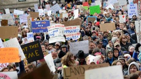 People gather in Copley Square to protest the muslim immigration ban enacted by President Trump on January 29, 2017 in Boston, Massachusetts. On Saturday night two federal judges issued a temporary emergency order halting part of the ban.