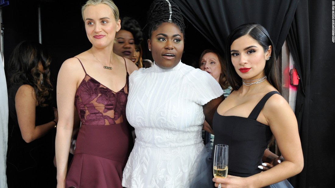 "From left, Taylor Schilling, Danielle Brooks, and Diane Guerrero pose for photos. They are part of the cast of ""Orange Is the New Black."""