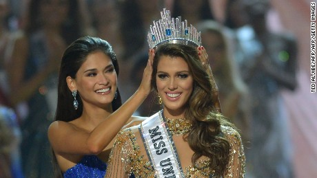 Miss Universe contestant Iris Mittenaere of France is crowned the new  winner by former Miss Universe Pia Wurtzbach of the Philippines.