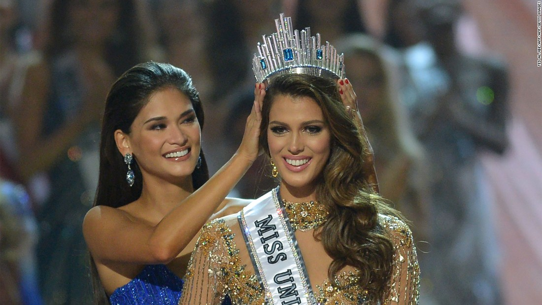 Contestant Iris Mittenaere of France is crowned the new Miss Universe by former Miss Universe Pia Wurtzbach of the Philippines.