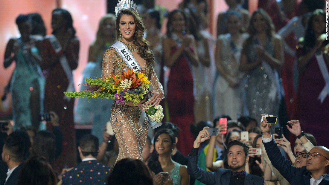 Mittenaere walks on stage after being crowned the winner of the Miss Universe pageant at the Mall of Asia Arena in Manila.