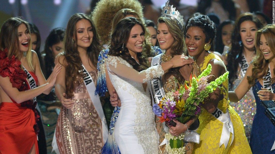 The new Miss Universe (centre R) is congratulated by the other candidates after being crowned at the pageant, on Monday.