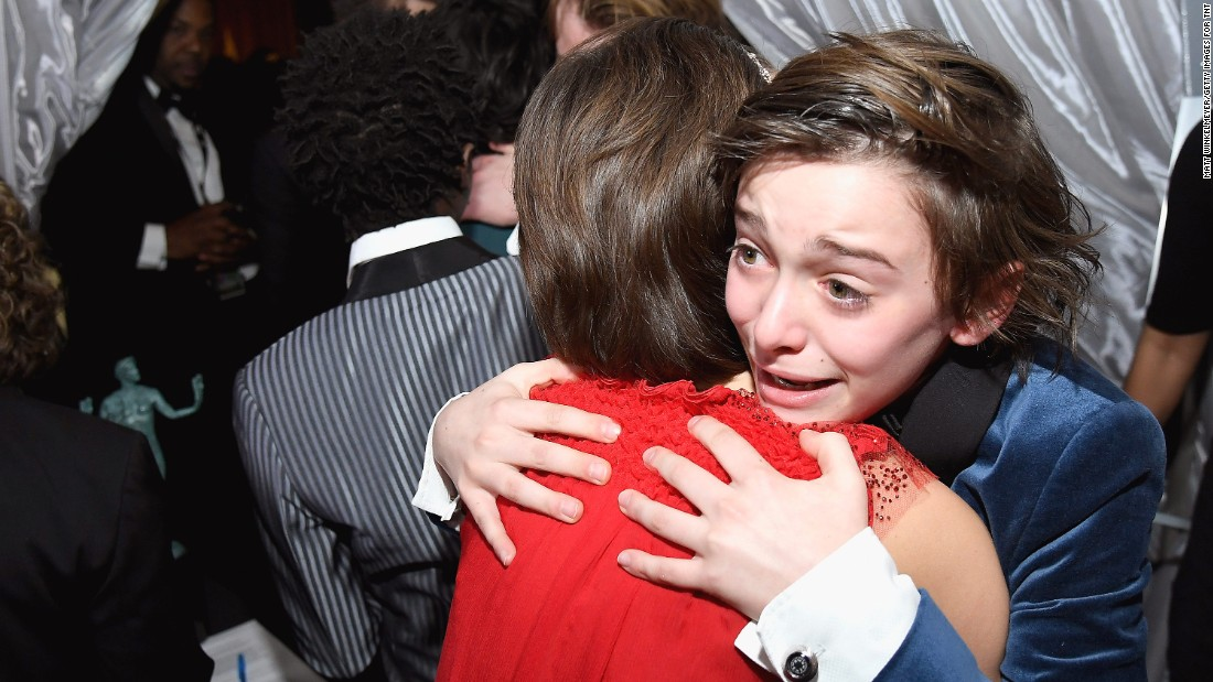 "Noah Schnapp, right, hugs Millie Bobby Brown backstage at the Screen Actors Guild Awards on Sunday, January 29. The ""Stranger Things"" cast won the award for Outstanding Ensemble in a Drama Series."