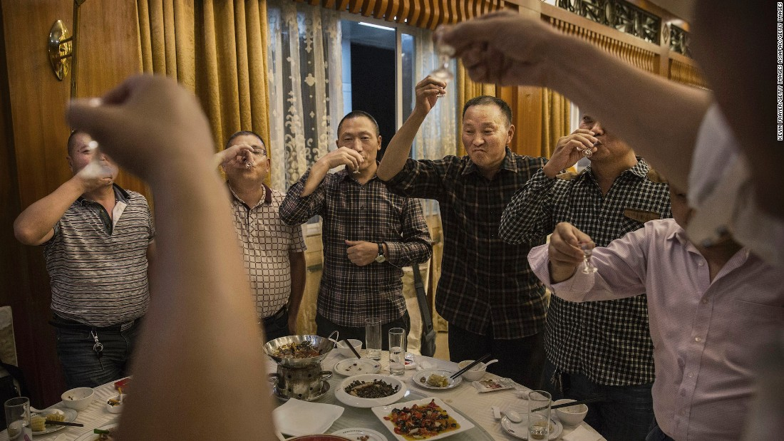 <strong>Moutai: </strong>Chinese men toast each other as they drink Moutai, the most famous brand of baijiu. Distilled from sorghum and rice, the spirit is the tipple of choice for everything from wedding receptions to business banquets.