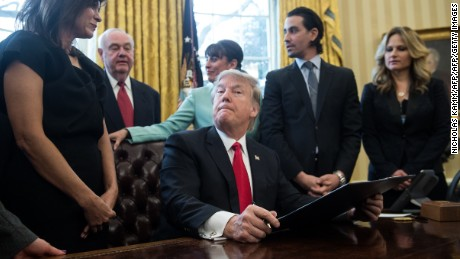 US President Donald Trump reacts after signing an executive order with small business leaders in the Oval Office at the White House in Washington, DC on January 30, 2017. / AFP / NICHOLAS KAMM        (Photo credit should read NICHOLAS KAMM/AFP/Getty Images)