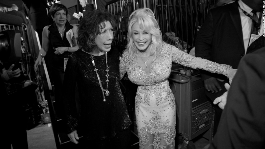 """9 to 5"" co-stars and long-time friends Lily Tomlin and Dolly Parton exit the stage after Tomlin was honored with the Screen Actors Guild lifetime achievement award."