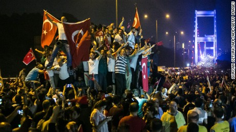 Turks take to the streets near the Fatih Sultan Mehmet bridge, which crosses the Bosphorus, in the early morning hours after a July, 15, 2016 coup attempt.