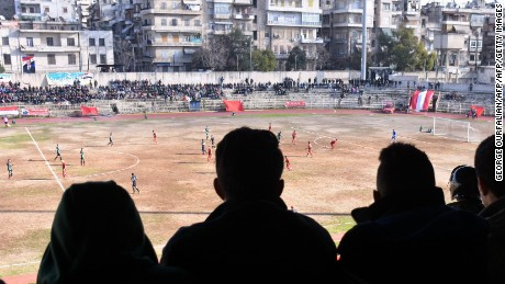 Fans attend the Syrian league football match between derby rivals Al-Ittihad and Al-Hurriya, on January 28, 2017, in the northern Syrian city of Aleppo. The Ittihad club beat Hurriya 2-1 in their first match on home turf since rebels took east Aleppo in 2012, dividing the northern city into a regime-held west and rebel-controlled east. / AFP / George OURFALIAN        (Photo credit should read GEORGE OURFALIAN/AFP/Getty Images)