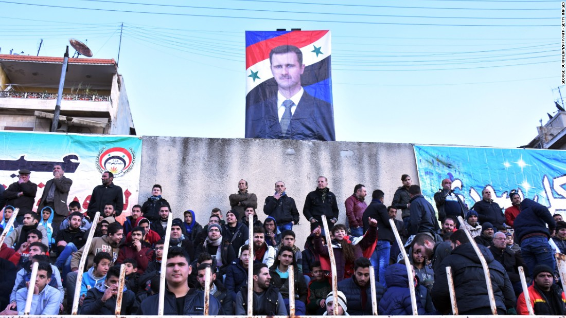 As did a poster of Syrian President Bashar al-Assad, which loomed over the stands.