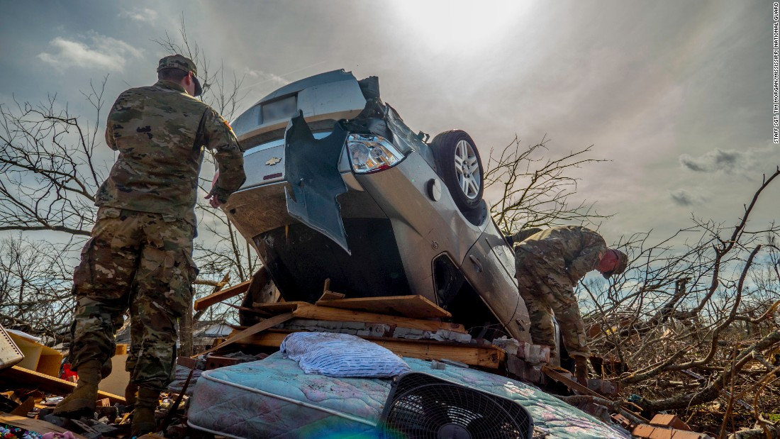 "Members of the Mississippi National Guard help in disaster-relief efforts after <a href=""http://www.cnn.com/2017/01/21/us/mississippi-southeast-severe-weather/"" target=""_blank"">a tornado</a> swept through the southern part of the state on Saturday, January 21."