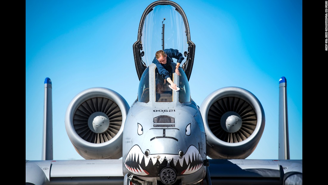 Senior Airman Felicia Anderson cleans cockpit glass on an A-10C Thunderbolt II at Nevada's Nellis Air Force Base on Wednesday, January 25.