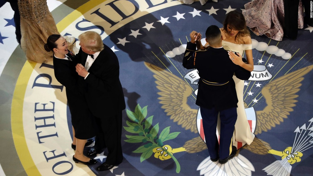 "President Trump dances with Navy Petty Officer 2nd Class Catherine Cartmell while his wife, Melania, dances with Army Staff Sgt. Jose A. Medina at the Salute to our Armed Services Inaugural Ball on Friday, January 20. <a href=""http://www.cnn.com/2017/01/20/politics/gallery/2017-inaugural-balls/index.html"" target=""_blank"">See more photos from the inaugural balls</a>"