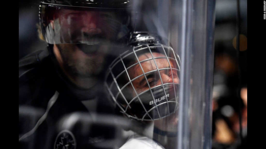 Pop star Justin Bieber is smashed into the glass by former hockey star Chris Pronger during a celebrity game in Los Angeles on Saturday, January 28. The game was part of the NHL's all-star festivities.