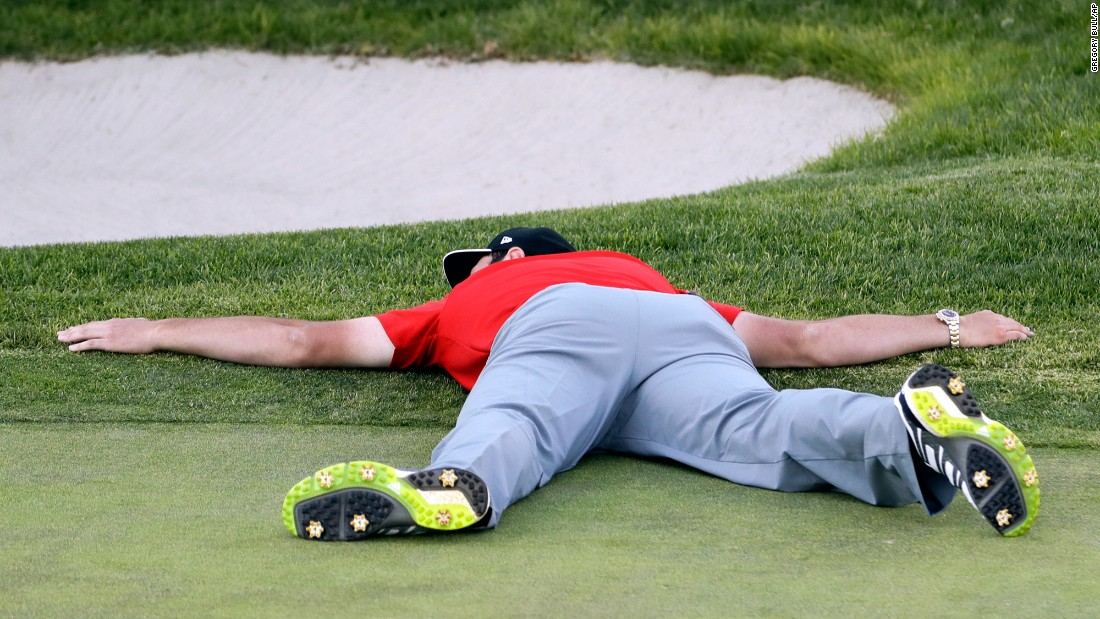 PGA Tour golfer Jon Rahm lies on the 18th green after winning the Farmers Insurance Open in San Diego on Sunday, January 29. It was his first victory on tour.