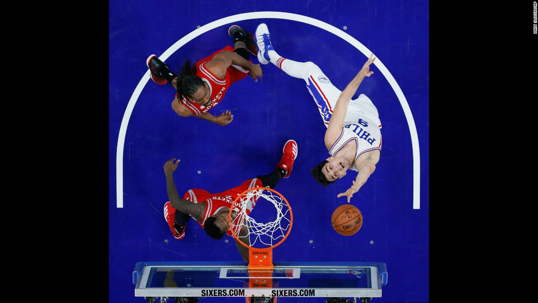 Philadelphia's Dario Saric, right, takes a shot against Houston on Friday, January 27.