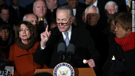 Senate Minority Leader Chuck Schumer and House Minority Leader Nancy Pelosi lead members of Congress during a protest on the steps of the U.S. Supreme Court January 30, 2017 in Washington, DC.