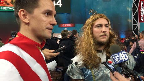 Austrian sportscaster Phillip Hajszan, left, says he has dressed up for Super Bowl media days five times.