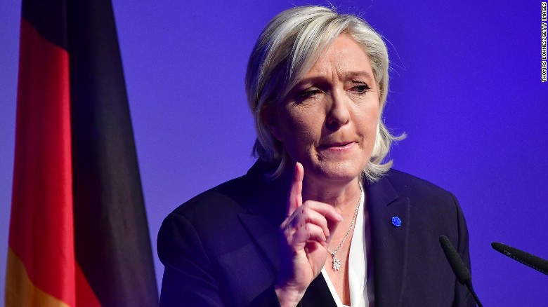 Le Pen refuses headscarf, cancels meeting