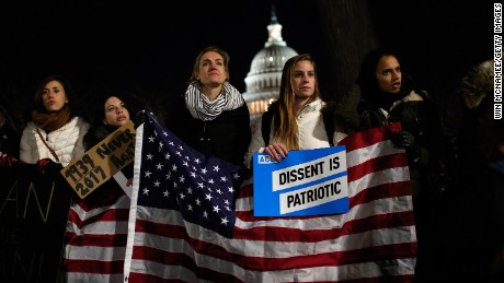 WASHINGTON, DC - JANUARY 30:  Protesters demonstrate as Senate Minority Leader Chuck Schumer (D-NY) and House Minority Leader Nancy Pelosi (D-CA) lead members of Congress during a protest on the steps of the U.S. Supreme Court and across the street from the U.S. Capitol January 30, 2017 in Washington, DC. Members of Congress joined refugees, immigrants and members of the Washington DC community in protesting  the Trump administrationÕs recent executive order banning immigration from seven predominantly Muslim countries.  (Photo by Win McNamee/Getty Images)
