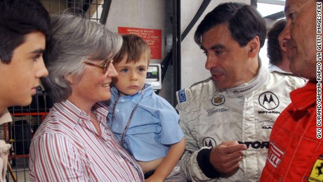 Fillon competes in the 2004 Le Mans Classic. His family cheers him on.