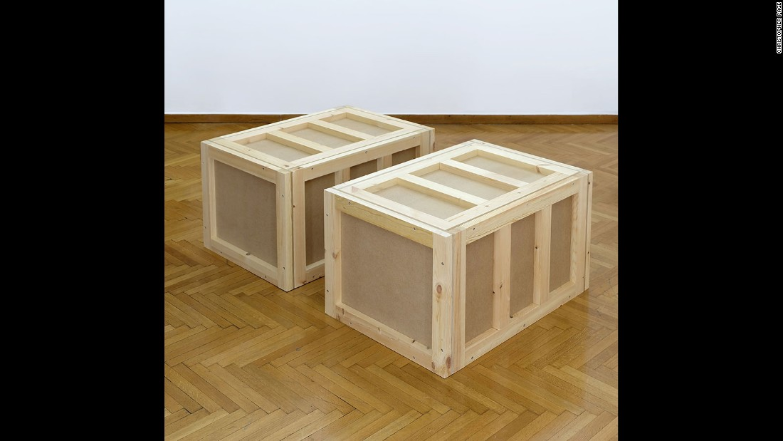 "Athens-based <a href=""http://www.christopherorlandopage.com/"" target=""_blank"">Christopher Page</a> has created two works of art in one, examining the nature of what it means to be constrained or displaced. In its 'Containment' form, the work consists of three identical shipping crates. <br />"