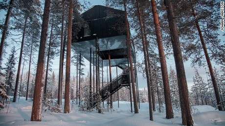 Hidden away among silent woods and snow banks in the Swedish Lapland, Treehotel has an apartment-like cabin is built into the canopy, 32 feet above the ground.