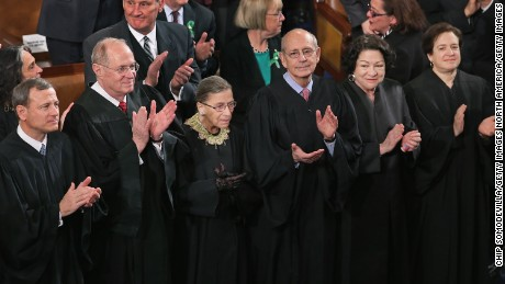 Members of the Supreme Court, (L-R) Chief Justice John Roberts and associate justices Anthony Kennendy, Ruth Bader Ginsburg, John Paul Stevens, Sonia Sotomayor and Elena Kagan, applaud as former President Barack Obama arrives to deliver his State of the Union speech before a joint session of Congress at the U.S. Capitol February 12, 2013 in Washington.