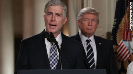 WASHINGTON, DC - JANUARY 31:  Judge Neil Gorsuch (L) speaks to the crowd as his wife Louise (R) looks on after U.S. President Donald Trump (2nd L) nominated him to the Supreme Court during a ceremony in the East Room of the White House January 31, 2017 in Washington, DC. If confirmed, Gorsuch would fill the seat left vacant with the death of Associate Justice Antonin Scalia in February 2016.  (Photo by Alex Wong/Getty Images)