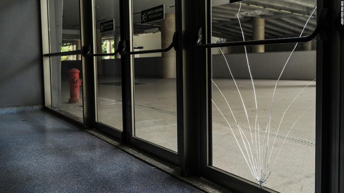 A broken window inside the stadium. Several windows and doors have been broken or damaged.