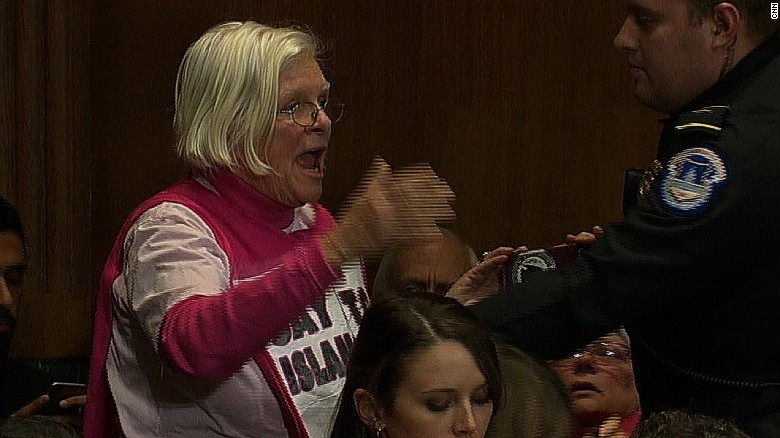 Protester shouts after Sessions approval
